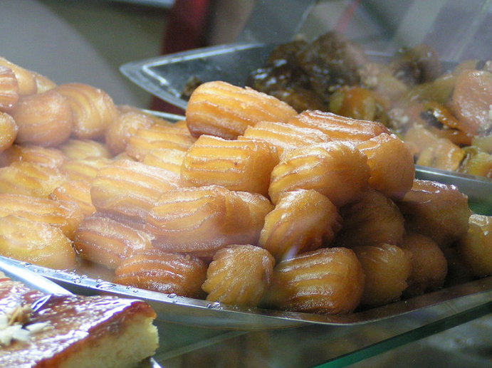 piles of tulumba, fried doughs soaked in syrup